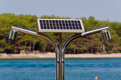 Solar, hot water shower on the seaside. Energy efficient solar shower on a beach Royalty Free Stock Images