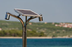 Solar, hot water shower on the seaside Stock Image