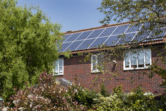 Solar house. Generic British house with solar panels Stock Images