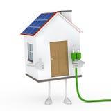Solar house figure. Solar house figur hold a green plug Stock Images