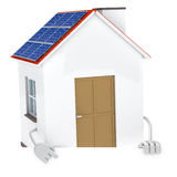 Solar house figure. Solar panel figure behind a white wall Stock Photography