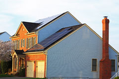 Solar Panel House. Single family house with Solar Panels on  roof for green energy Royalty Free Stock Photo