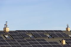 Solar installation for generating green electricity on the roof of a residential house. Solar installation generating green electricity on the roof of a royalty free stock photo