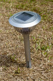 Solar lamp in the garden for saving energy. Royalty Free Stock Images
