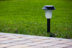 Solar Lantern is on the green lawn Royalty Free Stock Photography
