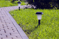 Solar Lantern is on the green lawn Stock Photo