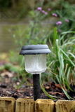 Solar light. Energy saving solar light in a garden Stock Photography
