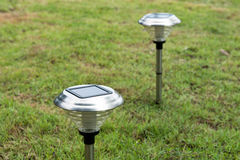Solar Light in the grass. Clean energy is popular. For Earth, Superfund, background Stock Photography