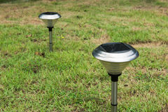 Solar Light in the grass. Clean energy is popular. For Earth, Superfund, background Royalty Free Stock Photography