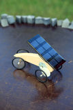 Solar mini car. A solar-powered toy vehicle which will move, if the sun is directed onto the solar cell Royalty Free Stock Photo