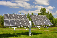 Solar module. On a meadow royalty free stock images
