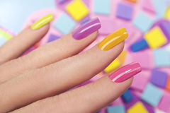 Solar nails. Solar nails are covered with multicolored with colored lacquer on the female hand Royalty Free Stock Image