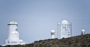 Solar and Nocturnal telescope towers of Teide Observatory Royalty Free Stock Images
