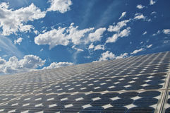 Solar panel. With beautiful blue sky and clouds in background Stock Photos