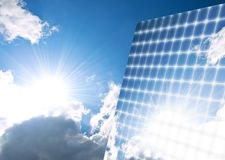 Solar panel. The sunny sky is reflected, in the solar panel