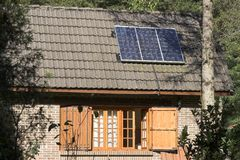 Solar panel. A solar panel on the roof of a country house Stock Images