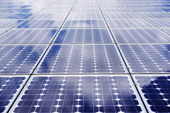 Solar panel. Photovoltaic solar panel with sky and cloud reflexions. Innovative, clean and renewable energy Stock Images