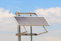 Solar Panel. Modern Solar Panel array set against a blue cloudy sky Stock Photo