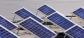 Solar panel. System of many blue solar panels on the roof Royalty Free Stock Photo