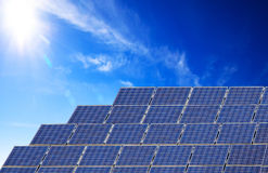 Solar panel. The sunny sky and a  solar panel Royalty Free Stock Photo