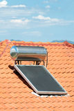 Solar panel. A solar panel used to heat water on a roof Stock Image