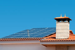 Solar Panel. Roof of a house equipped with a solar panel Stock Image