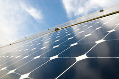 Solar panel. Close view of solar panels against a serene blue sky stock photo