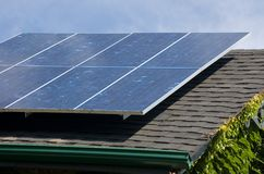 Solar panel. On a roof of old fashioned house stock photo