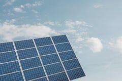 Solar panel against cloudy sky Stock Photos