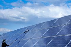 Solar panel, alternative electricity source - concept of sustainable resources, This`s the sun tracking systems, Cleaning will. Increase performance to high stock images