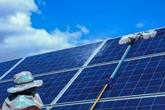 Solar panel, alternative electricity source - concept of sustainable resources, This`s the sun tracking systems, Cleaning will royalty free stock photography