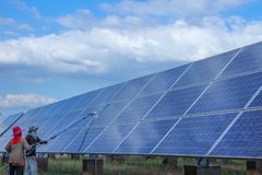 Solar panel, alternative electricity source - concept of sustainable resources, This`s the sun tracking systems, Cleaning will. Increase performance to high royalty free stock photography