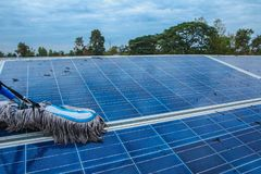 Solar panel, alternative electricity source - concept of sustainable resources, This`s the sun tracking systems, Cleaning will. Increase performance to high stock photo