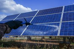 Solar panel, alternative electricity source - concept of sustainable resources, This`s the sun tracking systems, Cleaning will. Increase performance to high stock photos