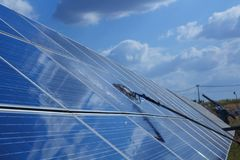 Solar panel, alternative electricity source - concept of sustainable resources, This`s the sun tracking systems, Cleaning will. Increase performance to high royalty free stock image