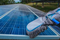 Solar panel, alternative electricity source - concept of sustainable resources, This`s the sun tracking systems, Cleaning will stock photography