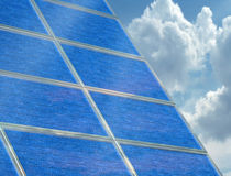 Solar panel array on a cloudy day Royalty Free Stock Images