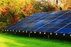 Solar Panel. In autumn morning on green lawn Stock Photos
