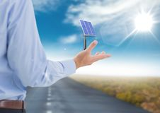 solar panel on businessman hand in the road stock photography