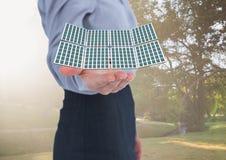 solar panel on businesswoman hand in the park vector illustration