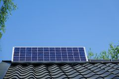 Solar panel / cell mounted on a rooftop. royalty free stock images