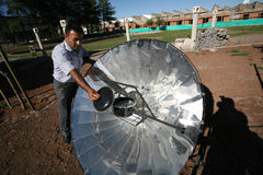 Solar Panel Cooking. Eco-friendly solar heater for boiling water in Turkey stock photography