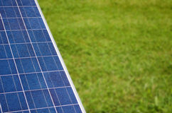 Solar panel with copyspace on green grass. Photovoltaic solar panel and grass, large copyspace Stock Photography