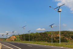 Solar  panel on electric pole on highway, use of Solar energy fo Royalty Free Stock Image