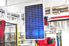 Production of solar cells assembled in a high tech factory - workplace. Solar panel factory automation - architecture and buildings - interior Royalty Free Stock Images