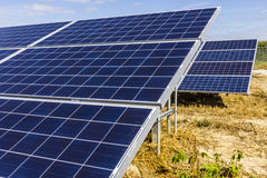 Solar Panel Farm. Corn Fields are Being Converted into Green Energy Areas Using Photovoltaic Cells III Royalty Free Stock Photos