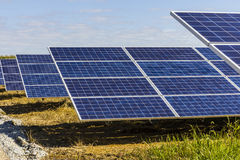 Solar Panel Farm. Corn Fields are Being Converted into Green Energy Areas Using Photovoltaic Cells IX Royalty Free Stock Photography