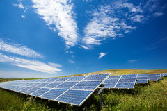 Solar panel field. Solar panel against the blue sky with clouds Royalty Free Stock Images