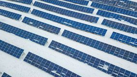 Solar Panel field with snow on panels. Photovoltaic power station stock images