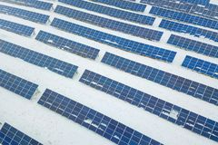 Solar Panel field with snow on panels. Photovoltaic power station stock image